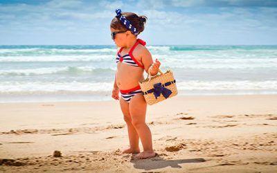 niña bolso playa 400x250 Vacaciones Singles